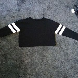 Long-sleeved black shirt with white stripes.